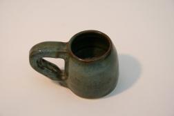Mug with bronzed rim